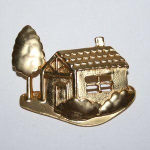 Vintage gold house brooch